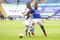 LEICESTER, ENGLAND - JULY 04: Jordan Ayew of Crystal Palace and Wilfred Ndidi of Leicester City in a battle for posession during the Premier League match between Leicester City and Crystal Palace at The King Power Stadium on July 4, 2020 in Leicester, United Kingdom. Football Stadiums around Europe remain empty due to the Coronavirus Pandemic as Government social distancing laws prohibit fans inside venues resulting in all fixtures being played behind closed doors. (Photo by MB Media)