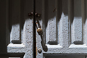 Ancient wooden front door and door knob handle in Ortigia, Syracuse, Sicily