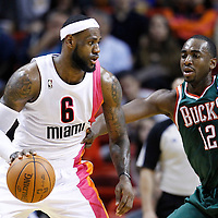 22 January 2012: Milwaukee Bucks small forward Luc Richard Mbah a Moute (12) defends on Miami Heat small forward LeBron James (6) during the Milwaukee Bucks 91-82 victory over the Miami Heat at the AmericanAirlines Arena, Miami, Florida, USA.