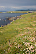 Cliffs of Moher coastal walk with the town of Doolin, background