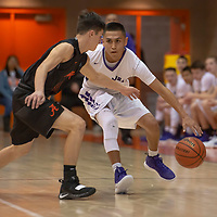 Gabe Lee (10) of Miyamura changes direction on Alex Fernandez (21) of Artesia with a crossover dribble during the Gallup Invitational Tournament game in Gallup. Miyamura won 63-56.
