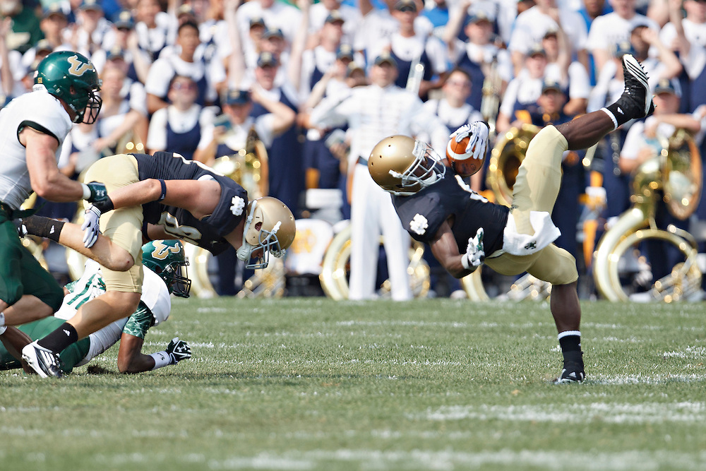 in action during NCAA football game between Notre Dame and South Florida.  The South Florida Bulls defeated the Notre Dame Fighting Irish 23-20 in game at Notre Dame Stadium in South Bend, Indiana.