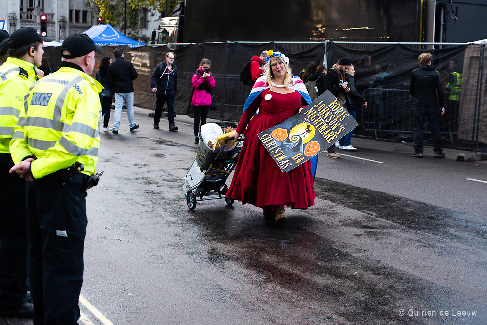 Police watch a demonstrator leaving the demonstration at the end of the People's Vote March in London. Boris Johnson's nightmare Before Christmas