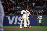 San Francisco Giants shortstop Brandon Crawford (35) and San Francisco Giants second baseman Joe Panik (12) celebrate a victory over the Los Angeles Dodgers at AT&T Park in San Francisco, California, on April 24, 2017. (Stan Olszewski/Special to S.F. Examiner)