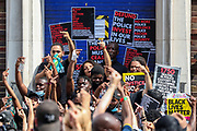 A man who said he was arrested after he tried to de-escalate the tension between armed police and the family of a 12-year-old child who they had arrested addresses his raged response against the police in front of a crowd of anti-police brutality protestors carrying banners, placards, and flags in front of Tottenham Police Station in North London on Saturday, Aug 8, 2020. <br /> Ms. Agyepong said Kai had been left traumatized by the incident, becoming anxious if she even leaves him just to nip to the shops.<br /> Black Lives Matter enters the 11th weekend of continuous demonstrations against racial injustice in Britain. <br /> Anger against systemic levels of institutional racism has raged and continued throughout the United States, Britain and worldwide; sparked by the death of George Floyd who died on May 25 after he was restrained by Minneapolis police in the United States. (VXP Photo/ Vudi Xhymshiti)