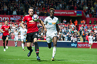Football - 2017 / 2018 Premier League - Swansea City vs. Manchester United<br /> <br /> Phil Jones of Manchester United & Tammy Abraham of Swansea City chase —<br /> , at Liberty Stadium.<br /> <br /> COLORSPORT/WINSTON BYNORTH