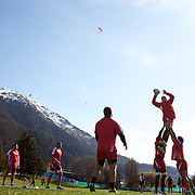 The Georgian team training at Recreation Park, Queenstown, in preparation for the IRB Rugby World Cup as paragliders descending from skyline lookout, prepare to land in a nearby field. Queenstown, New Zealand, 7th September 2011. Photo Tim Clayton...