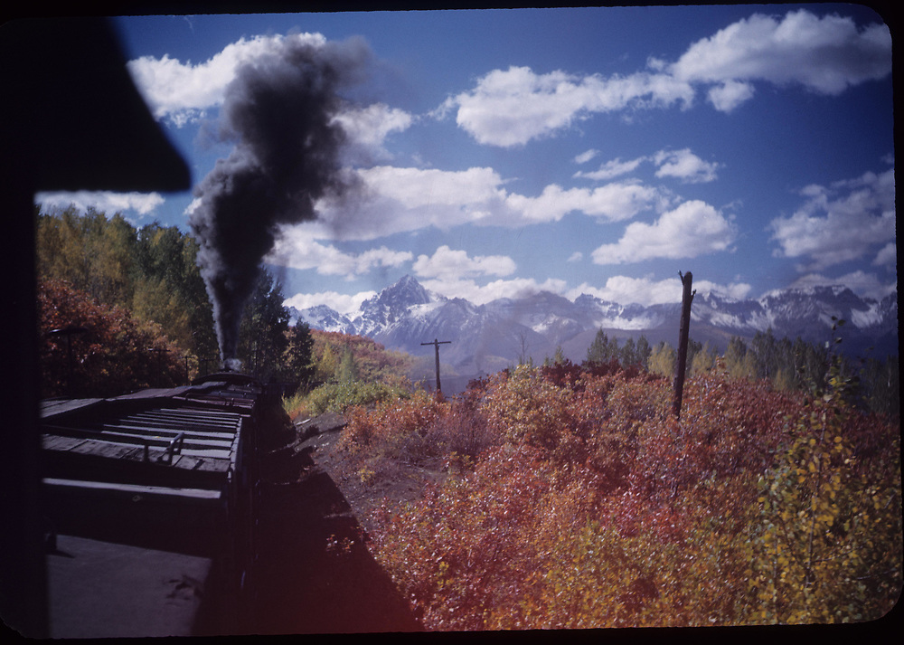 RGS freight possibly in Dallas Divide area. Mt. Sneffels in San Juans in background, as seen from the caboose.<br /> RGS  Dallas Divide area ?, CO  Taken by Rasmussen, Forest<br /> Same image as RDS072-004.<br /> Thanks to Don Bergman for additional information.