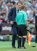 Football - 2016 / 2017 Premier League - West Ham United vs. AFC Bournemouth<br /> <br /> West Ham Manager Slaven Bilic questions the linesman over a decision at The London Stadium.<br /> <br /> COLORSPORT/DANIEL BEARHAM