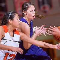 120713       Cable Hoover<br /> <br /> Gallup Bengal Kaylee Tsinigine (12) steals the ball from Clovis Wildcat Brandi Gomez (2) during the final of the Gallup Invitational Saturday at Gallup High School.