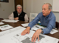 Tom Cochran and Dick Weaver look over the plans including the Community Room and improvements to be made at Sunrise Towers and the new construction of the Sunrise House at Laconia Housing on Wednesday morning.  (Karen Bobotas/for the Laconia Daily Sun)