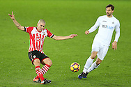 Oriol Romeu of Southampton (l) and Fernando Llorente of Swansea city ® in action. Premier league match, Swansea city v Southampton at the Liberty Stadium in Swansea, South Wales on Tuesday 31st January 2017.<br /> pic by  Andrew Orchard, Andrew Orchard sports photography.
