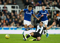 Football - 2019 / 2020 Premier League - Newcastle United vs. Everton<br /> <br /> Dominic Calvert-lewin of Everton vies with Isaac Hayden of Newcastle United, at St James' Park Stadium.<br /> <br /> COLORSPORT/BRUCE WHITE
