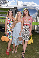 Left to right, Amber Le Bon, Hum Fleming and Sabrina Percy at the Laureus polo Cup at Ham Polo Club, Ham, London, England. 21 June 2018.