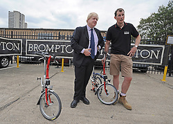 © licensed to London News Pictures. LONDON, UK.  02/06/11. Boris Johnson (L) is shown the manufacturing process at Brompton Bicycles in West London by its CEO Will Butler-Adams (R). The Mayor of London Boris Johnson visits two major manufacturing firms today, 02 June 2011, to see the role they play in supporting London's economy and why the UK's capital city  is so critical to their continued success. He called in to Fuller's in Chiswick, London's only traditional family brewery, to see their new multi-million pound brewing facility. He went on to visit Brompton bike factory. Where he met Brompton inventor Andrew Ritchie, who still owns the famous company and remains its Technical Director.  Photo credit should read Stephen Simpson/LNP