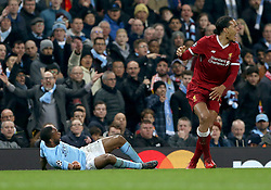 Manchester City's Raheem Sterling (left) goes over Liverpool's Virgil van Dijk during the UEFA Champions League, Quarter Final at the Etihad Stadium, Manchester.
