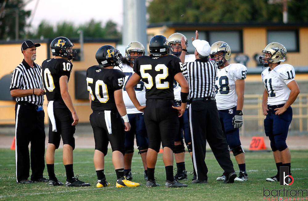Team captains from Antioch and Napa High Schools watch as officials flip a coin before the start of thier game on Friday, Sept. 23, 2011 in Antioch. (Photo by Kevin Bartram)