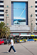 Large picture of a Greek island at Plateia Omonia. Omonia Square (Plateia Omonias) is the center of Athens, and is composed of the actual square together with the surrounding streets, open areas and assemblage of grand buildings that include banks and offices. The neighboring area of Exarcheia (Εξάρχεια) to the north, dominated by the Athens Polytechnic and its famous band of anarchists, is a bohemian district with lots of bars and clubs visited by students, intellectuals and people who are into alternative culture. Omonia Square is an important transport hub, especially for buses. Athens is the capital and largest city of Greece. It dominates the Attica periphery and is one of the world's oldest cities, as its recorded history spans around 3,400 years. Classical Athens was a powerful city-state. A centre for the arts, learning and philosophy.