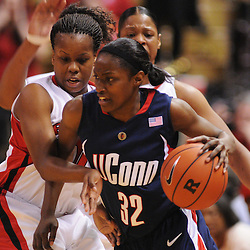 Mar 2, 2009; Piscataway, NJ, USA; Rutgers guard Epiphanny Prince (10) defends Connecticut guard Kalana Greene (32) during the second half of Rutgers game against nationally rated #1 Connecticut at the Louis Brown Athletic Center.  Connecticut won 69-59 to finish their regular season a perfect 30-0.