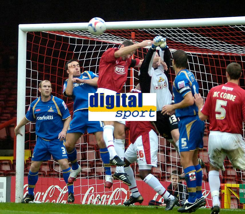 Photo: Ed Godden.<br />Bristol City v Doncaster Rovers. Coca Cola League 1. 28/10/2006. Bristol's Louis Carey fouls Doncaster keeper Ben Smith.