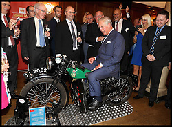 Image ©Licensed to i-Images Picture Agency. 06/09/2016. London, United Kingdom. Royal Mail  500th Anniversary. <br /> <br /> Prince Charles, Prince of Wales tries a 1933 BSA 500cc motorbike used for delivering telegrams as he attends a reception to mark the 500th Anniversary of the Royal Mail at Merchant Taylor's Hall on September 6, 2016 in London, England<br /> <br /> Picture by  i-Images / Pool