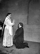 His Grace Most Reverend Dr. Charles Mc Quaid, Archbishop of Dublin and Primate of Ireland, ordained four new priests all for  English Dioceses, at Holy Cross College Clonliffe..Pictured P. McCoy (Limerick) blessing his mother..12.03.1960.