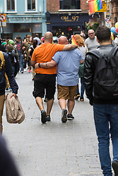 Portland Place, London, June 25th 2016. Thousands of LGBT people and their supporters gather for Pride in London, a colourful celebration of the hard-won rights of lesbian, gay, bisexual and transgender  people. PICTURED: Two men walk arm in arm through Chinatown.