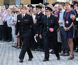 London Fire Brigade Commissioner Dany Cotton (front left) and her Staff Officer Keeley Foster (front right) at Winchester House, in central London, after they joined firefighters and LFB staff observing a minute's silence in memory of those people who died in last week's fire at Grenfell Tower.