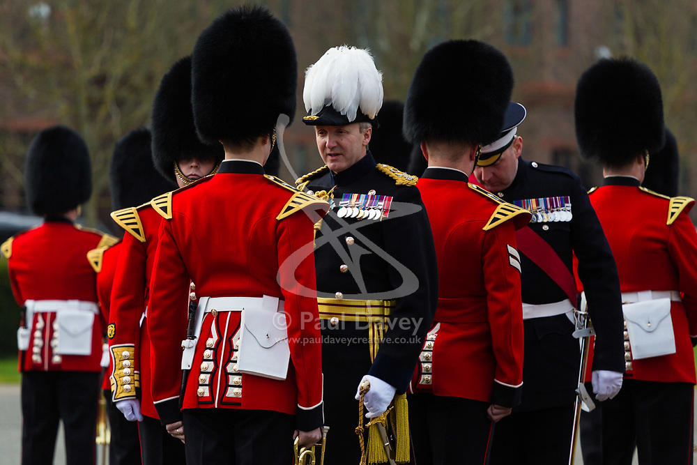 The 1st Battalion Coldstream Guards undergoes inspection by Major General Commanding the Household Division, Major General Ben Bathurst at Victoria Barracks in Windsor, Berkshire. The battalion has been chosen to Troop its Colour for the Queen's Birthday Parade on 9th June.  Before then these operational soldiers have to perfect hundreds of precision ceremonial drill moves and achieve a standard of turnout of uniform, equipment and bearing which is nothing short of excellence. PICTURED: Major General Ben Bathurst inspects a member of the Band of the Welsh Guards. <br /> <br /> Victoria Barracks, Windsor, Berks, February 21 2018.