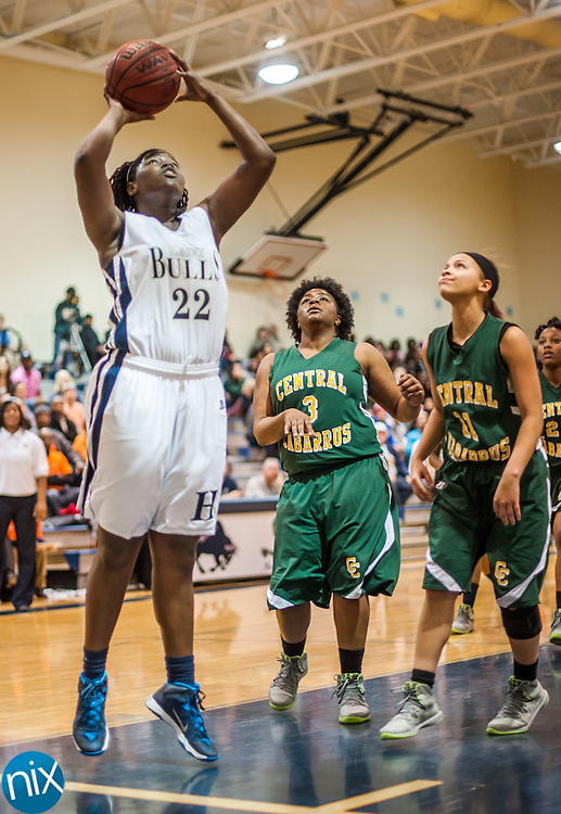 Hickory Ridge's Zharia Brown takes a shot against Central Cabarrus Friday night at Hickory Ridge High School in Harrisburg. The Ragin' Bulls won the game 58-52.