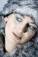 studio shot portrait of a beautiful woman russian type in a fur coat and hat