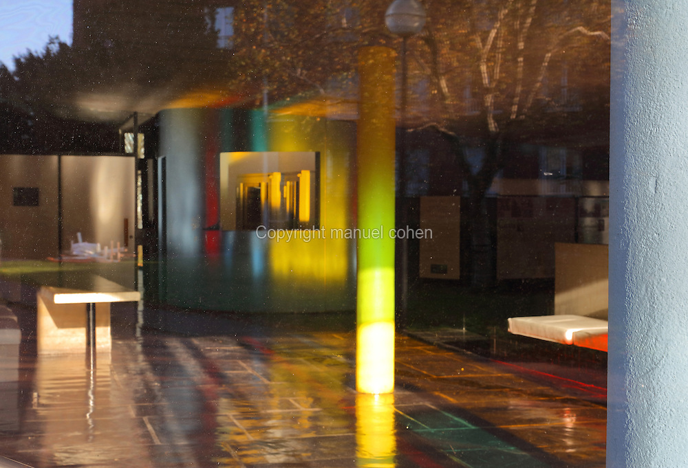 Inside the Maison du Bresil or Brazil House, designed by Le Corbusier (Charles-Edouard Jeanneret, 1887-1965) and Lucio Costa, 1902-1998, and inaugurated in 1954, with reflections from the coloured glass windows, in the Cite Internationale Universitaire de Paris, in the 14th arrondissement of Paris, France. The building is listed as a historic monument. The CIUP or Cite U was founded in 1925 after the First World War by Andre Honnorat and Emile Deutsch de la Meurthe to create a place of cooperation and peace amongst students and researchers from around the world. It consists of 5,800 rooms in 40 residences, accepting another 12,000 student residents each year. Picture by Manuel Cohen. L'autorisation de reproduire cette œuvre doit etre demandee aupres de l'ADAGP/Permission to reproduce this work of art must be obtained from DACS.