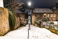 Edinburgh, Scotland, UK. 21 January 2020. Scenes taken between 4am and 5am in Edinburgh city centre after overnight snow fall. The Vennel stairs in the Old Town Iain Masterton/Alamy Live News