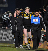 Wycombe, GREAT BRITAIN,   Wasps' Tom REES, is helped from the pitch after injuring his ankle, during the London Wasps vs Harlequins at Adam's Park Stadium, Bucks on Sun 04.01.2009. [Photo, Peter Spurrier/Intersport-images]