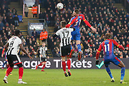 Crystal Palace forward Connor Wickham (21) jumps high to challenge Grimsby Town forward Harry Cardwell (17) in the air during The FA Cup 3rd round match between Crystal Palace and Grimsby Town FC at Selhurst Park, London, England on 5 January 2019.