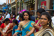 Hindu devotees participate in the annual Tamil chariot festival at the Murugan Temple in Highgate, London, England. Thousands attend the colourful celebration as the temple's Goddess Amman (Tamil for Mother) is paraded on a beautifully decorated chariot pulled by the people through the streets around the temple, which brings to a close the four week Mahotsava festival on 17th July 2016.