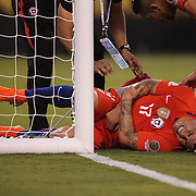 EAST RUTHERFORD, NEW JERSEY - JUNE 26:  Gary Medel #17 of Chile feels his arm after running into the goal post during the Argentina Vs Chile Final match of the Copa America Centenario USA 2016 Tournament at MetLife Stadium on June 26, 2016 in East Rutherford, New Jersey. (Photo by Tim Clayton/Corbis via Getty Images)