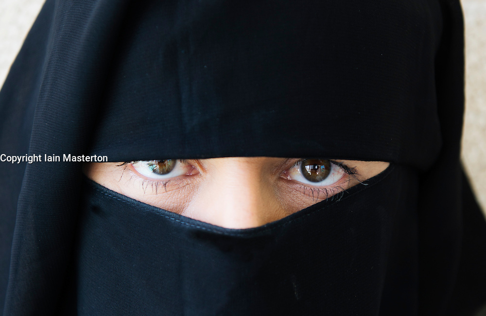 Arab woman wearing traditional black niqab face covering