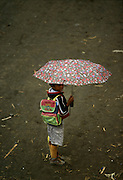 A boy coming from school in Paul Valley with an umbrella. The northeast area of Santo Antao has a microclimate that makes it the only part of the archipelago where it rains regularly and where many vegetables and fruits grow.
