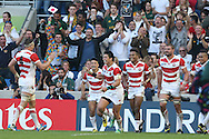 Japan's Full Back Ayumu Goromaru scores a try and celebrates during the Rugby World Cup Pool B match between South Africa and Japan at the Community Stadium, Brighton and Hove, England on 19 September 2015. Photo by Phil Duncan.
