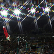 Gymnastics - Olympics: Day 5 Kohei Uchimura #154 of in action during his routine on the Horizontal Bar during the Artistic Gymnastics Men's Individual All-Around Final at the Rio Olympic Arena on August 10, 2016 in Rio de Janeiro, Brazil. (Photo by Tim Clayton/Corbis via Getty Images)<br /> <br /> (Note to editors: A special effects starburst filter was used in the creation of this image)