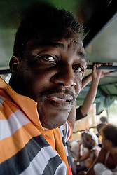 30 August, 2005. New Orleans Louisiana. Hurricane Katrina aftermath. <br /> Pastor T.L Robinson of Victory Praise ministries is evacuated from the lower 9th ward to the Superdome. Mr Robinson's wife was pulled from his arms by rapidly rising flood waters in the storm and has no idea if she survived. Hundreds of desperate evacuees from the lower 9th ward await transportation to the Superdome where approximately 20,000 storm evacuees are housed.<br /> Photo Credit: Charlie Varley/varleypix.com