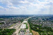 Nederland, Zuid-Holland, Rotterdam, 10-06-2015; Polder Vockestaert. Aanleg A4 Midden-Delfland. De nieuwe weg loopt van Delft naar het Kethelplein tussen de wijken Holy-Zuid (Vlaardingen) en Groenoord (Schiedam).  In de voorgrond de ingang van de tunnel.<br /> Construction A4 between Delft and Rotterdam.<br /> luchtfoto (toeslag op standard tarieven);<br /> aerial photo (additional fee required);<br /> copyright foto/photo Siebe Swa