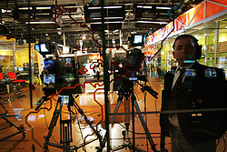 Inside the Globovision news studio. Private media in Venezuela say they face various challenges with the introduction of a new media law.  Supporters of the law, which limits the showing of sex and violence during daylight hours, says it is designed to protect children who may be watching TV.  Opponents claim it is an attempt by President Hugo Chavez to limit what opposition news media can broadcast, and cover, that may negatively reflect the government.  Television stations like Globovision, a 24 hour news channel,  must constantly monitor the material they show from their own broadcasts  as well as what they air from other networks like CNN in order to ensure they comply with the law.  In recent months Globovision has had to censor daytime footage from Iraq, a Jennifer Lopez video and street clashes in Caracas.