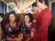 Students from the Hotan university go for a visit to Kashgar for exams. Life inside the train - mostly Muslim Uighur people  ride this train.