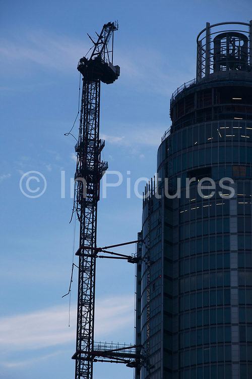 London, UK. Wednesday 16th January 2013. Scene after a helicopter crash into a crane working on St George Tower, a skyscraper at Vauxhall. The helicopter crashed into the crane as it was waiting to land at a nearby helipad in dense fog. The aircraft then plummeted 180 feet to the road below exploding and killing 2 people and injuring 13.
