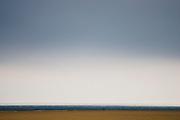 Couple walk along Brancaster Beach, Norfolk, United Kingdom