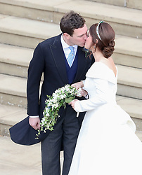 Princess Eugenie and Jack Brooksbank kiss on the steps of St George's Chapel in Windsor Castle after their wedding.