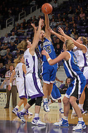 Creighton guard Kelsey Crites (15) drops a pass to forward Sara Cain (42) in the lane, over Kansas State forward Carolyn McCullough (44) in the first half at Bramlage Coliseum in Manhattan, Kansas November 13, 2006.  K-State beat the Bluejays 94-79.<br />