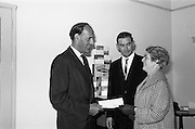 21/09/1963<br /> 09/21/1963<br /> 21 September 1963<br /> Presentation of £100 Kleenex prize at Goodbody's Dun Laoghaire, Co. Dublin. Picture shows Mr E.F. Sutton, Director, Goodbody's Ltd., Presenting a cheque for £100 to Mrs Maureen Grogan, 6 Sion Row, ferry bank, Waterford, who won it in the Kleenex competition. Also in the picture is Mr Brian McMahon, Marketing Manager, Goodbody's Limited.